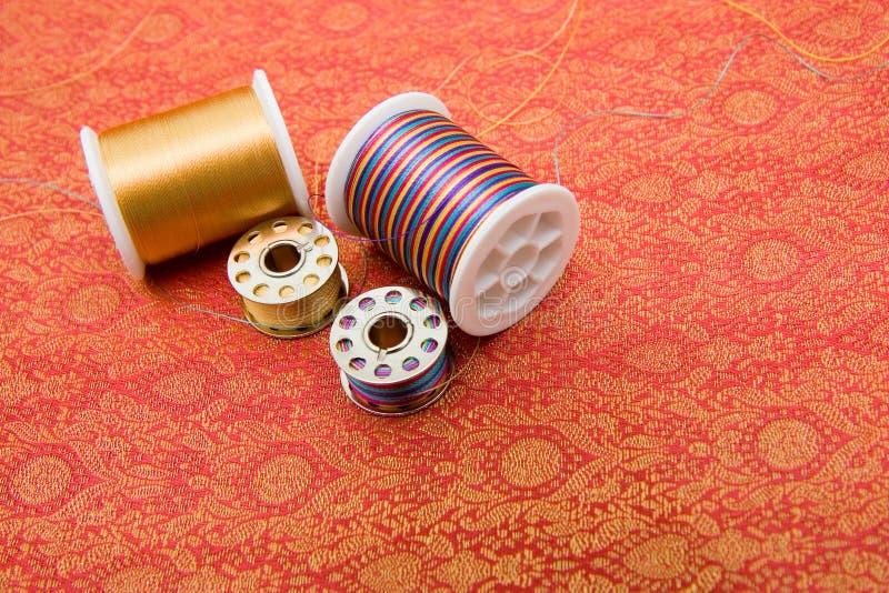 Spools on fabric royalty free stock photos