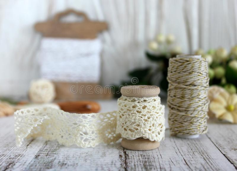 Spools with lace trim and baker`s twine. stock photos