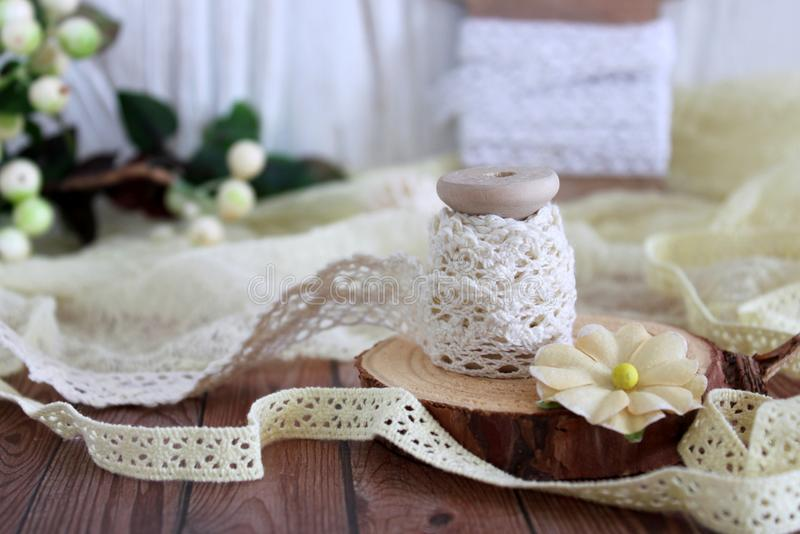 Spools with lace trim. Laces and trims. Crafting and sewing supplies stock image
