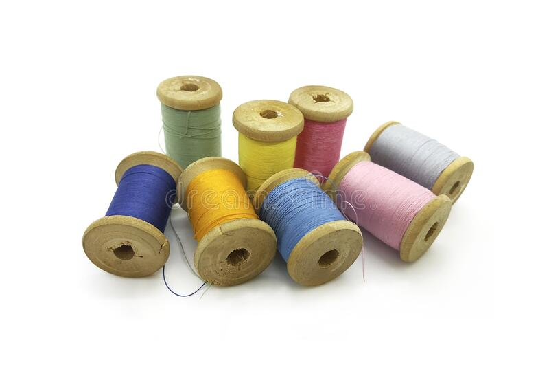 Spools of multi-colored threads on a white background stock photos