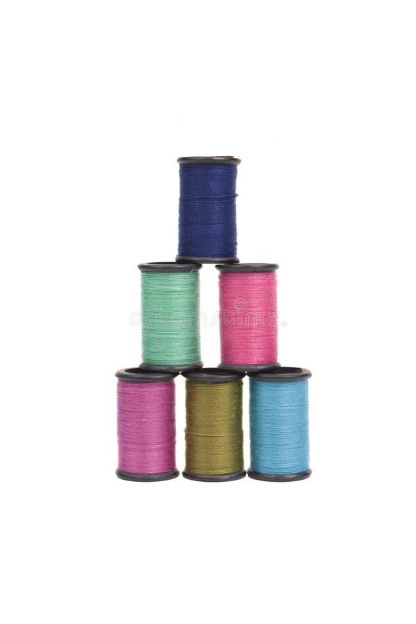 Spools of thread in a pyramid
