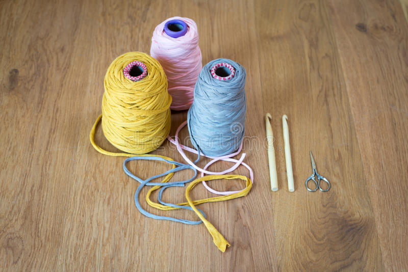 Spools of Yarn, Crochet Hooks, and Thread Snips stock photos