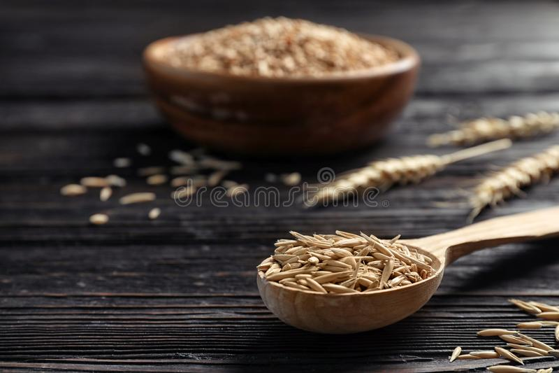 Spoon with barley on wooden table stock photo