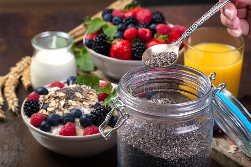 Spoon of chia. Bowl with berries. stock photo