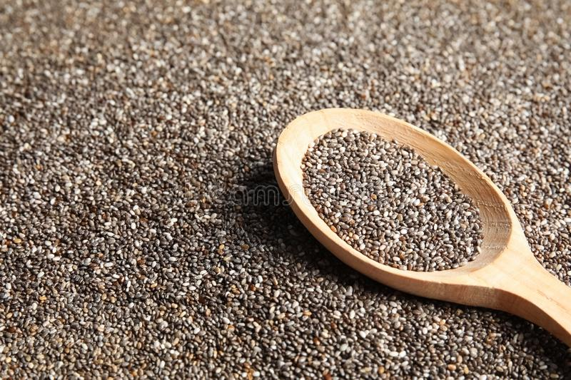 Spoon of chia seeds on grains, closeup. Space for text stock photos