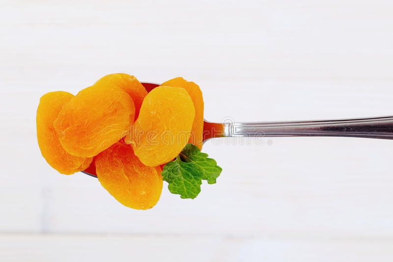 Download Spoon Of Dried Apricots Stock Photo - Image: 83710033