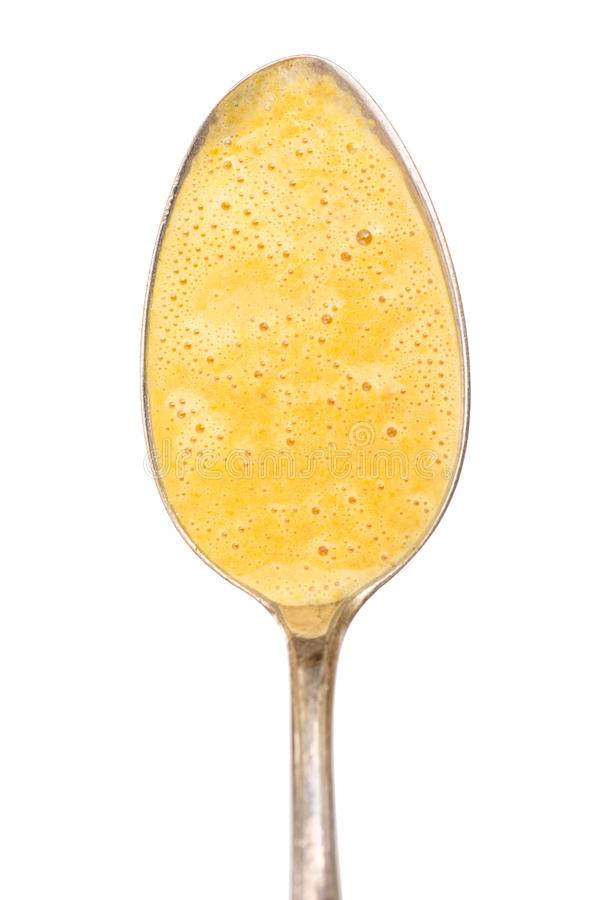 Download Spoon With Foamed Up Carrot Soup Royalty Free Stock Photos - Image: 34271348
