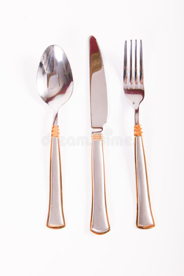 Spoon, fork and knife. Dining utensils such as spoon, fork and knife on a white background royalty free stock photography