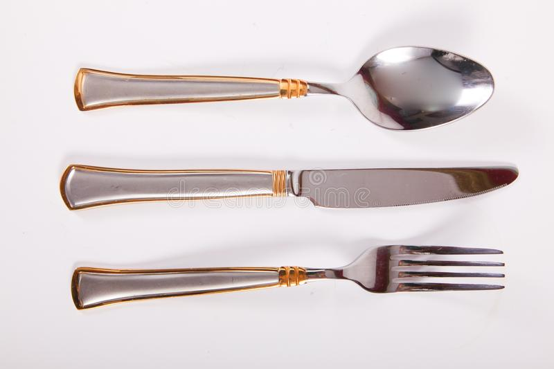Spoon, fork and knife. Dining utensils such as spoon, fork and knife on a white background royalty free stock images