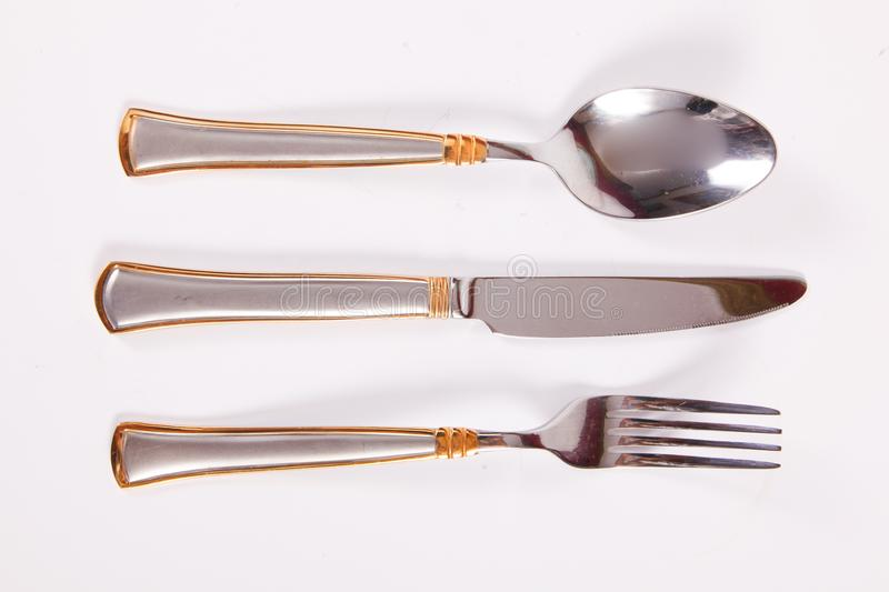 Spoon, fork and knife. Dining utensils such as spoon, fork and knife on a white background royalty free stock photo