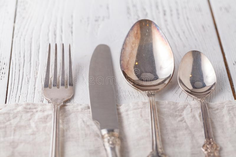 Spoon, fork and a knife lie on serviette. It is on a white background stock photography