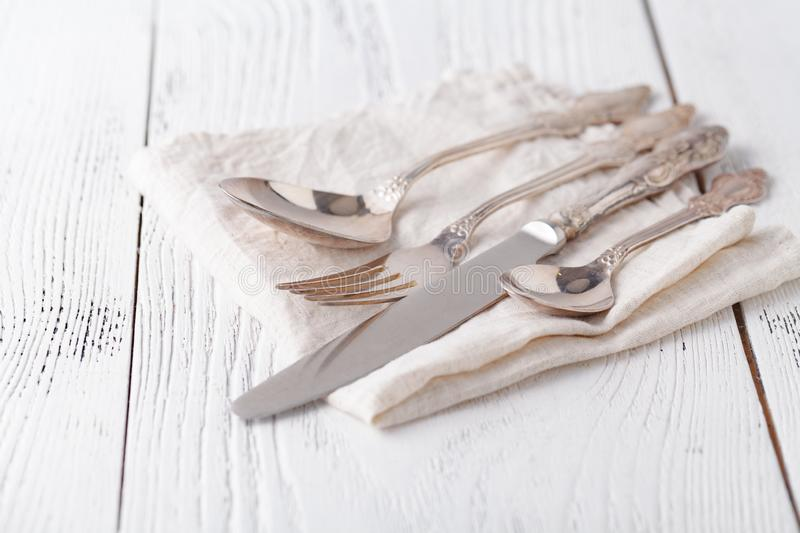 Spoon, fork and a knife lie on serviette. It is on a white background royalty free stock images