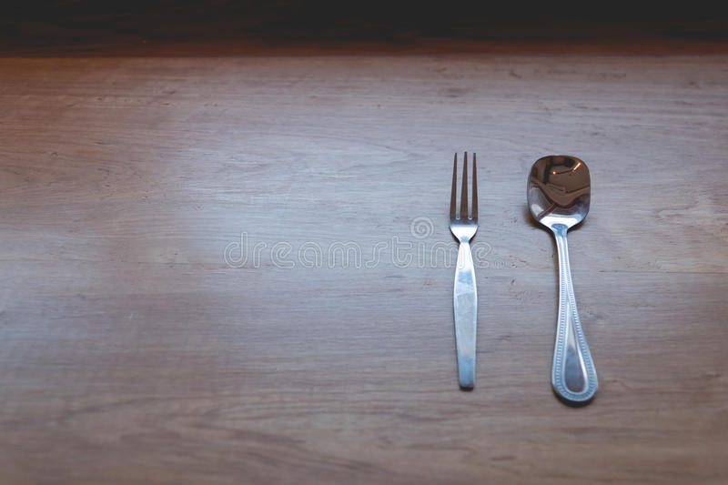Spoon fork on wood table , kitchenware of restaurant background royalty free stock photos