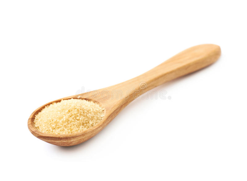 Spoon full of cane sugar. Wooden spoon full of stevia cane sugar isolated over the white background stock images