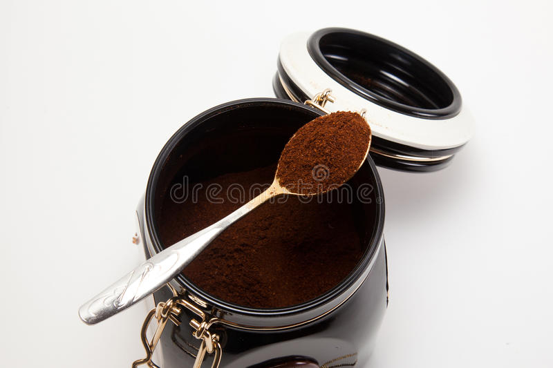 Spoon with ground coffee. Spoon with ground natural coffee stock image