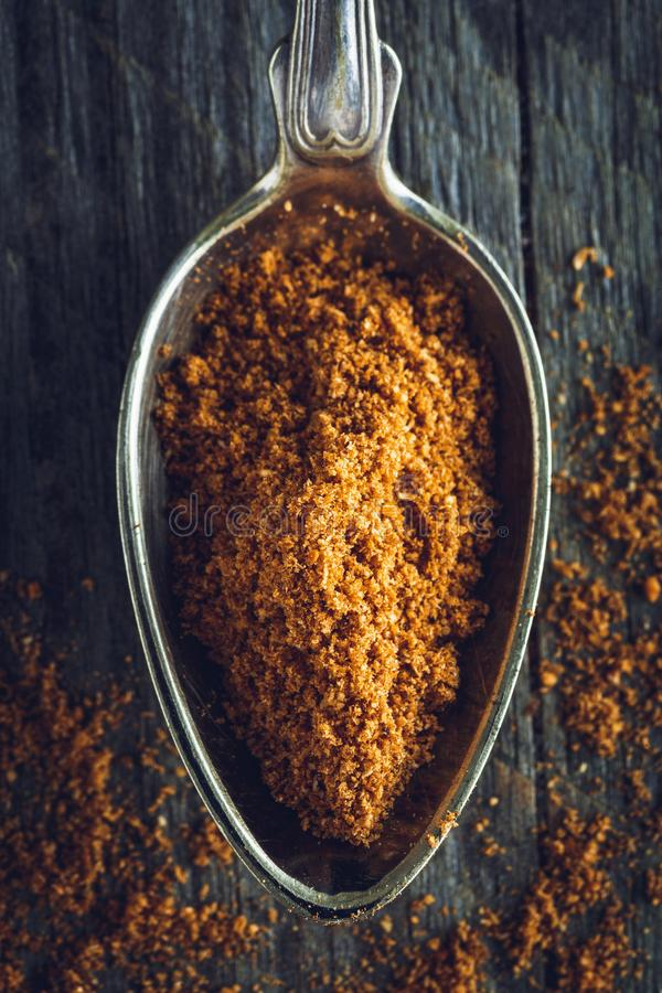 Spoon of ground nutmeg powder royalty free stock photos
