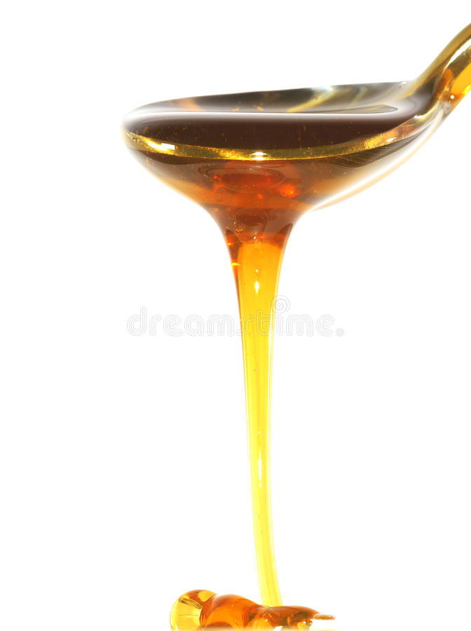 A spoon with honey royalty free stock photography
