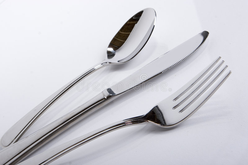 Spoon knife fork on a angle stock image
