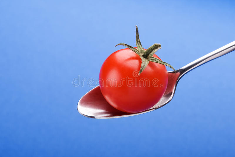 Download Spoon With Little Tomato Royalty Free Stock Photography - Image: 14190317