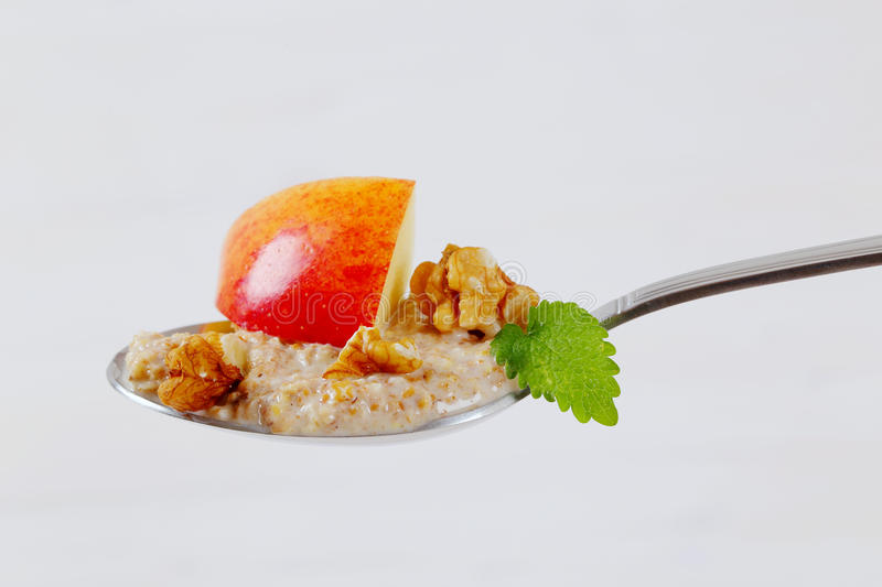 Download Spoon Of Oatmeal Porridge With Apples And Walnuts Stock Image - Image: 83707169
