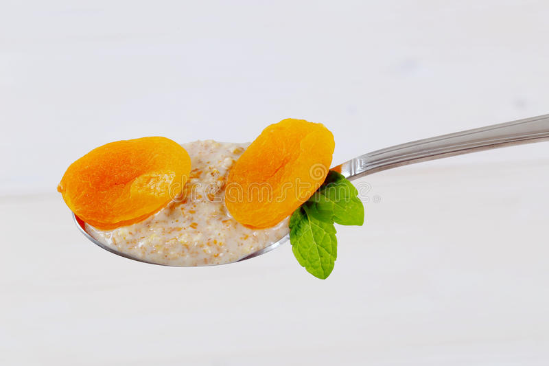 Download Spoon Of Oatmeal Porridge With Apricots Stock Photo - Image: 83706419