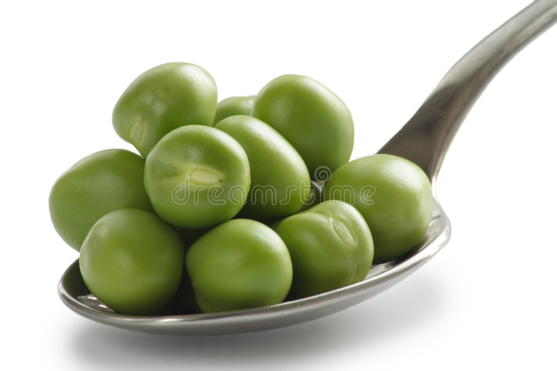 Spoon of Peas royalty free stock photography