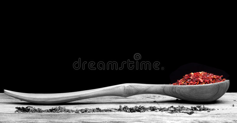 Spoon with pepper on wooden table royalty free stock photos