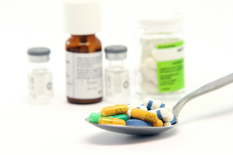 Spoon pills and bottles royalty free stock photography