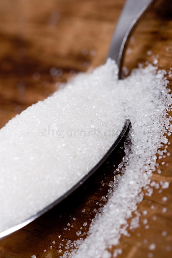 Spoon with sugar royalty free stock images