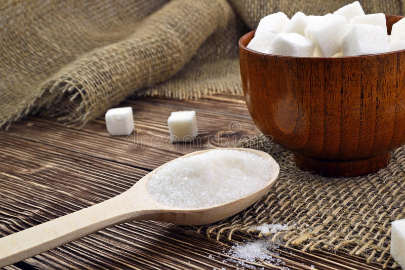 Spoon with sugar on the table stock images