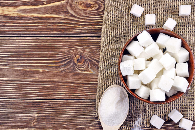 Spoon with sugar on the table royalty free stock photography