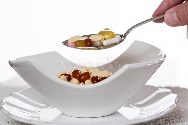 Download Spoon Of Vitamins Over Bowl Of Tablets Stock Photo - Image: 25995280