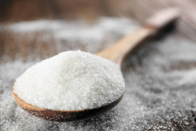 Spoon with white sugar stock photography