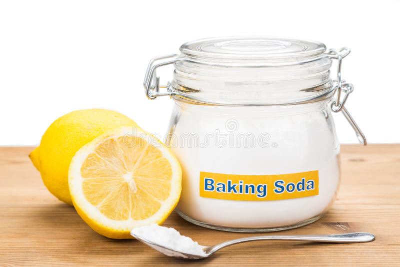 Spoonful of baking soda and lemon fruits for multiple holistic u. Sages royalty free stock photo