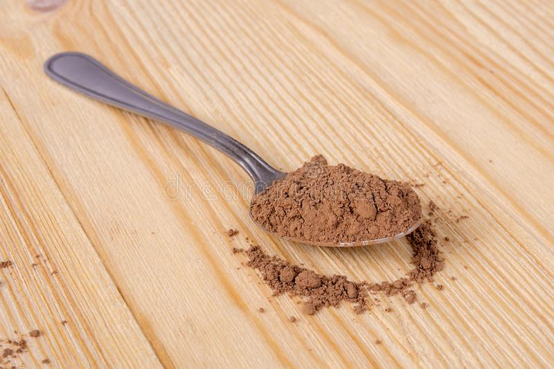 Spoonful Of Cocoa Powder. A spoonful of baking cocoa powder royalty free stock photos