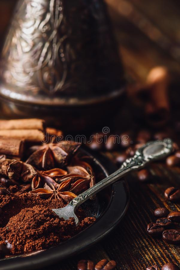 Spoonful of Coffee. Spoonful of Ground Coffee and Spices on Metal Plate royalty free stock images