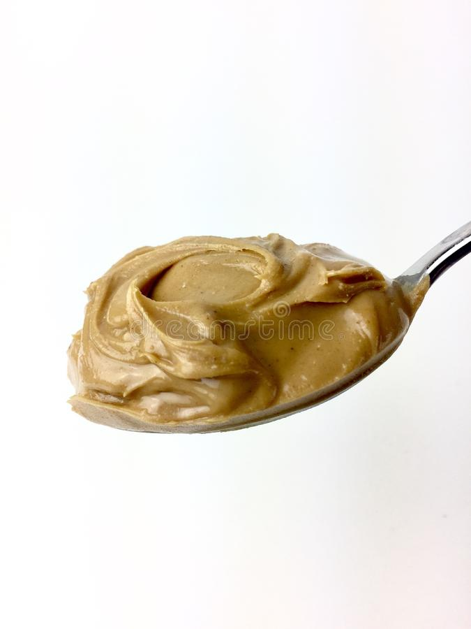 Spoonful of creamy peanut butter royalty free stock photo