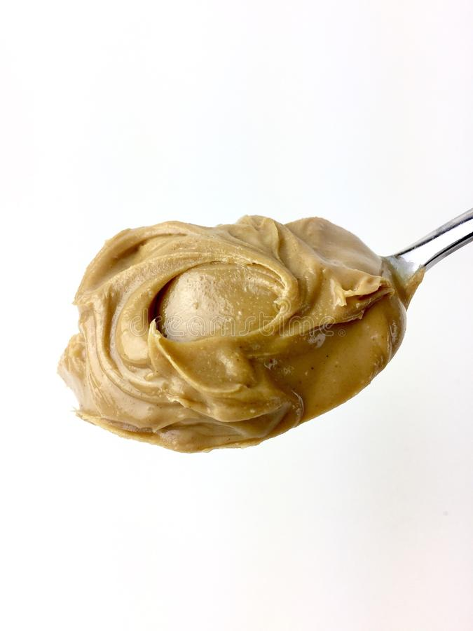 Spoonful of creamy peanut butter royalty free stock photography