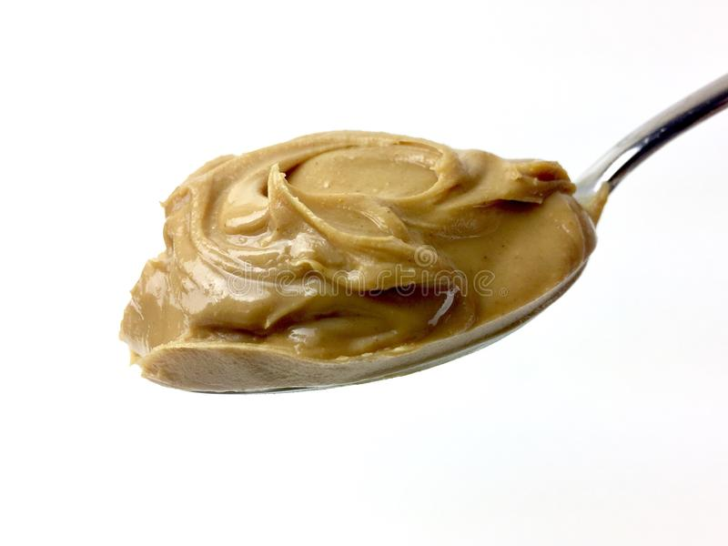 Spoonful of creamy peanut butter stock photo