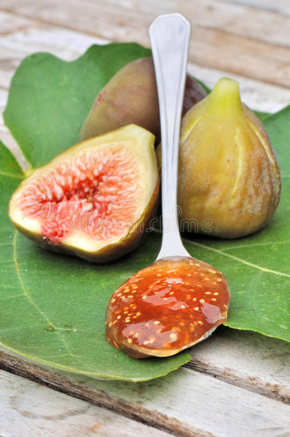 Spoonful of fig jam stock photos