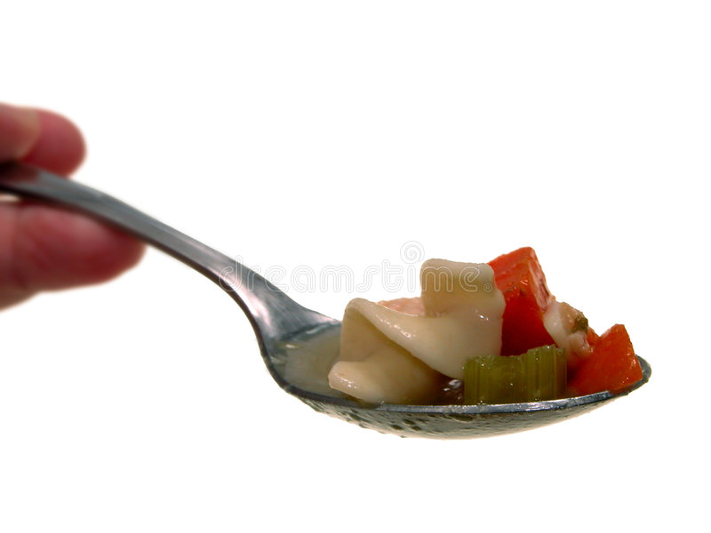 Spoonfull of Chunky Chicken Noodle Soup royalty free stock photo