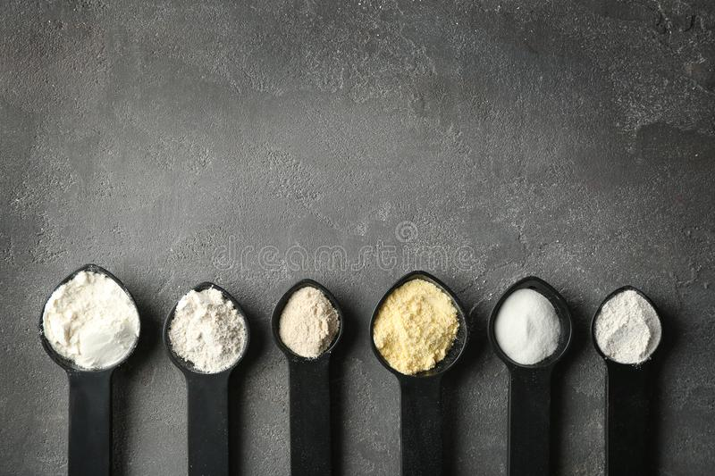 Spoons with different types of flour royalty free stock image