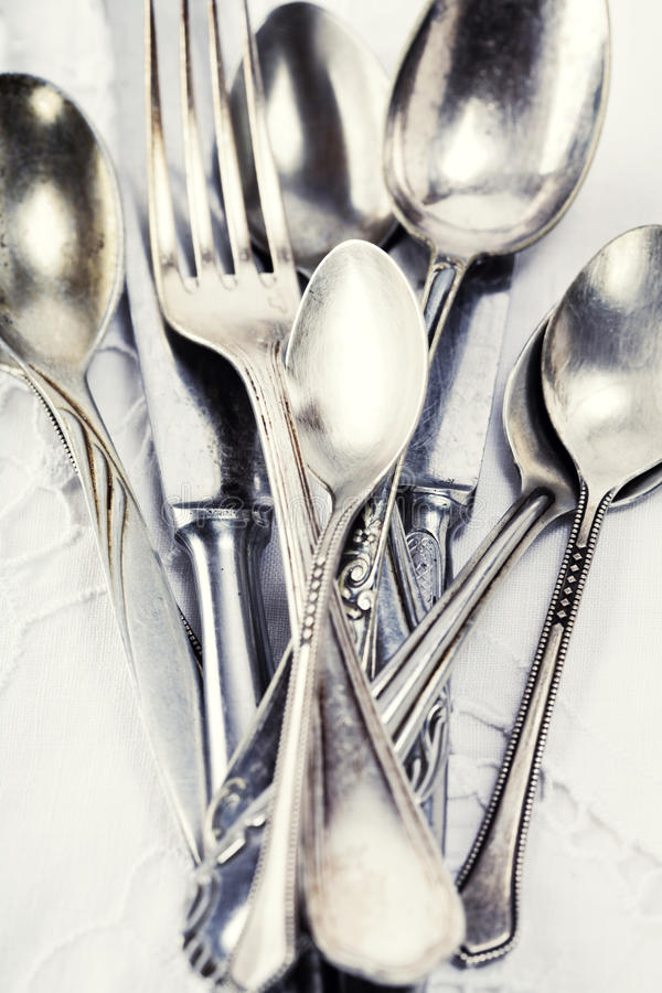 Spoons, forks and knifes stock photo