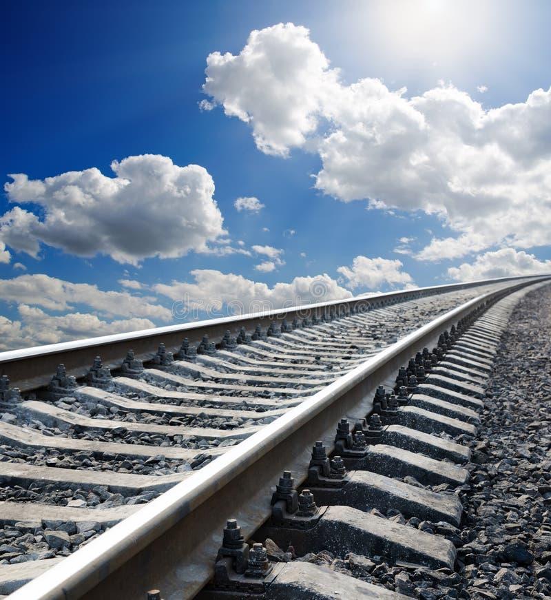 Spoorweg aan horizon stock fotografie