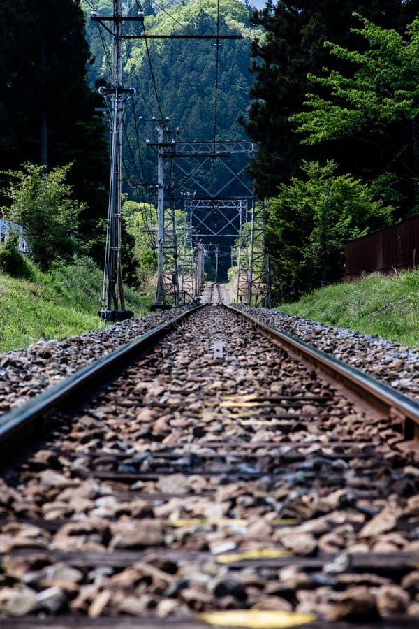 Spoorweg die weg langzaam verdwijnen stock afbeeldingen