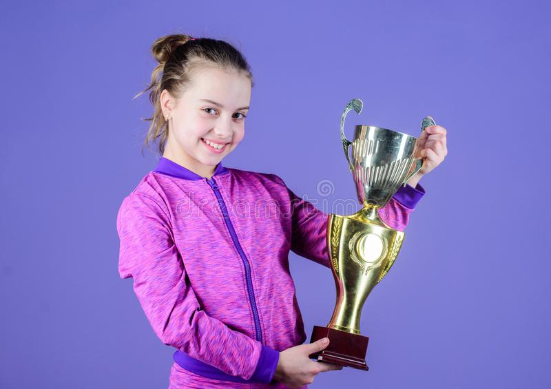 Sport achievement. Celebrate victory. Girl hold golden goblet. Importance of capturing evidence of kids progress. Proud. Of her achievement. Celebrating stock images