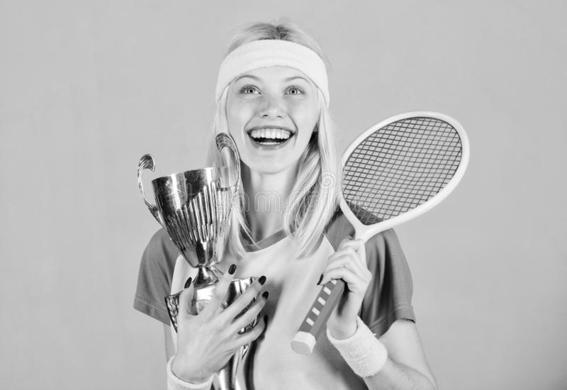 Sport achievement. Celebrate victory. Tennis champion. Athletic girl hold tennis racket and golden goblet. Win tennis. Game. Tennis player win championship stock images