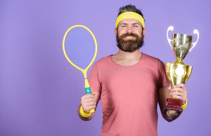 Sport achievement. Celebrate victory. Tennis champion. Athletic man hold tennis racket and golden goblet. Win tennis. Game. Tennis player win championship. Man royalty free stock images