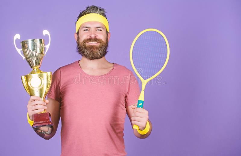 Sport achievement. Celebrate victory. Tennis champion. Athletic man hold tennis racket and golden goblet. Win tennis. Game. Tennis player win championship. Man royalty free stock photography