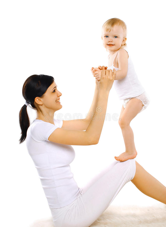 Sport, active, leisure and family concept - happy mom and baby stock photos